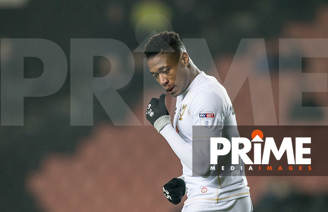 Chuks Aneke of Milton Keynes Dons gets a bloody nose with his first touch of the ball during the Sky Bet League 1 match between MK Dons and Chesterfield at stadium:mk, Milton Keynes, England on 22 November 2016. Photo by Andy Rowland.