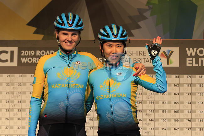 Natalya Saifutdinova and Makhabbat Umutzhanova of Kazakhstan at sign on for the start of the Women Elite Road Race of the UCI World Championships 2019 running 149.4km from Bradford to Harrogate, England. 28th September 2019.<br /> Picture: Eoin Clarke | Cyclefile<br /> <br /> All photos usage must carry mandatory copyright credit (© Cyclefile | Eoin Clarke)