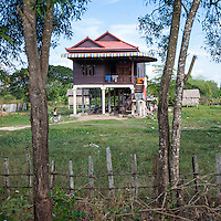 Cambodia.  Typical Modern Rural House, with Living Quarters above the Ground-level Storage Area.