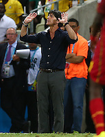 Germany coach Joachim Loew gestures an apology after kicking the ball away from a Ghana throw in