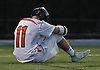 Zach Amelia #11 of Babylon dejectedly sits in silence after Babylon's 11-10 overtime loss to Westlake in the NYSPHSAA varsity boys lacrosse Class D state semifinals at Adelphi University in Garden City, NY on Wednesday, June 7, 2017. Up 10-7 late in the fourth quarter, Babylon surrendered three goals in the final three mintues of regulation before falling in overtime.