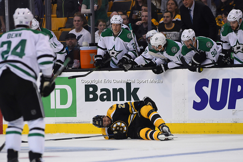Tuesday, November 3, 2015: Boston Bruins center Chris Kelly (23) lies on the ice during the first period of the National Hockey League game between the Dallas Stars and the Boston Bruins held at TD Garden, in Boston, Massachusetts. Eric Canha/CSM