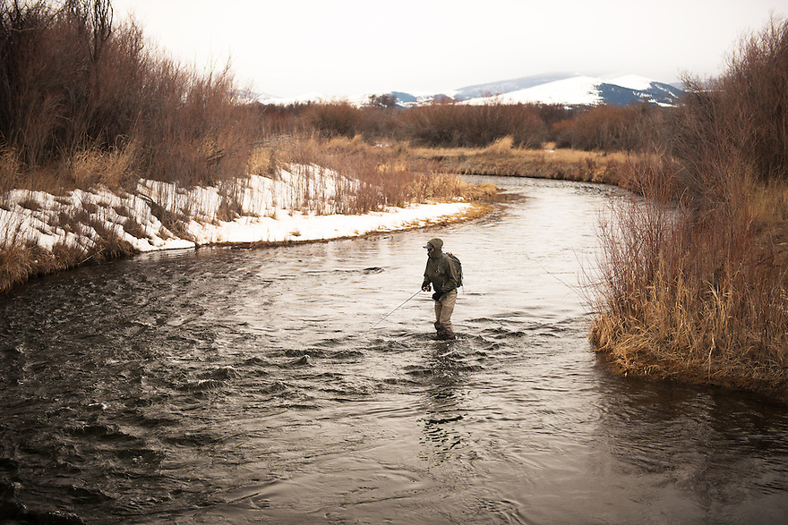 An angler fishes the Clark Fork River on March 9, 2014. The Clark Fork River begins at the confluence of Warm Springs Creek and Silver Bow Creek near Warm Springs.