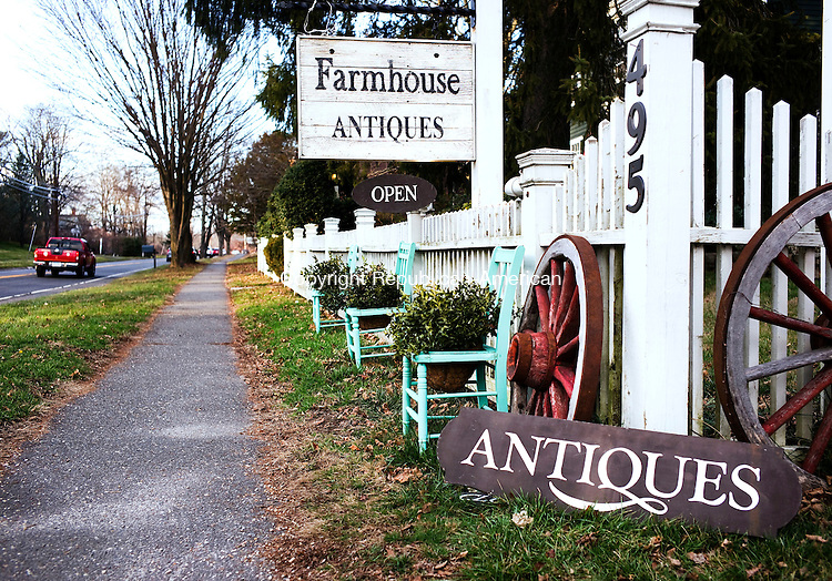Woodbury, CT- 03 January 2016-010316CM03- COUNTRY LIFE--- A chair and white fence is shown in front of Farmhouse Antiques in Woodbury on Sunday.   Christopher Massa Republican-American