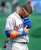 New York Mets second baseman Robinson Cano (24) bows his head as the National Anthem is played prior to the game against the Washington Nationals at Nationals Park in Washington, DC on March 30, 2018.<br /> Credit: Ron Sachs / CNP<br /> (RESTRICTION: NO New York or New Jersey Newspapers or newspapers within a 75 mile radius of New York City)