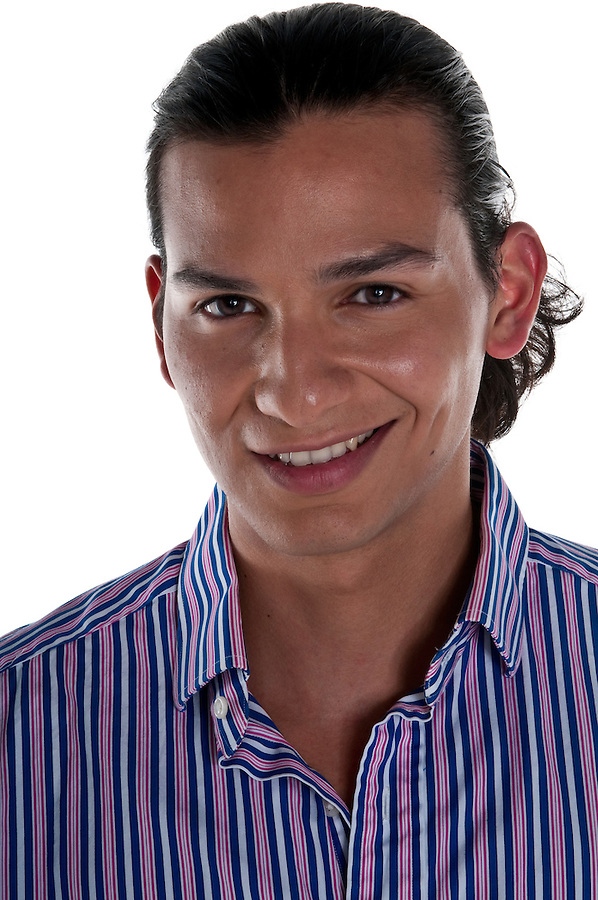 Portrait of succesful latin young man smiling.