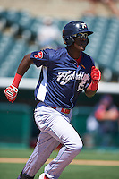 Reading Fightin Phils third baseman Gustavo Pierre (15) runs to first during a game against the Bowie Baysox on July 22, 2015 at Prince George's Stadium in Bowie, Maryland.  Bowie defeated Reading 6-4.  (Mike Janes/Four Seam Images)
