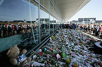 AMSTERDAM, NETHERLANDS - JULY 23: People observe a minut of silence at Schiphol Airport on July 23, 2014 in Amsterdam,Netherlands. The Dutch government declares a national day of mourning to commemorate the victims of Malaysian Airlines. The  flight MH17 was travelling from Amsterdam to Kuala Lumpur when it crashed killing all 298 on board including 80 children. The aircraft was allegedly shot down by a missile and investigations continue over the perpetrators of the attack. - Photo by Paulo Amorim