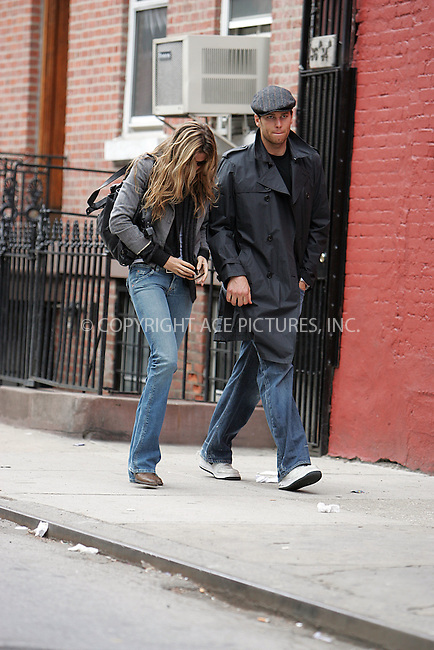 WWW.ACEPIXS.COM . . . . . ....***EXCLUSIVE TO ACE PICTURES - PLEASE CALL FOR RATES***....April 13 2008, New York City....Supermodel Gisele Bundchen and New England Patriots quarterback Tom Brady look glum as they leave her West Village townhouse. As they spot our photographer, Gisele reaches for Tom's hand and holds it until she realises that she has left her belt half undone. They pause briefly to allow her to do it up and then disappear downtown in a cab.....Please byline: DAVID MURPHY - ACEPIXS.COM.. . . . . . ..Ace Pictures, Inc:  ..(646) 769 0430..e-mail: info@acepixs.com..web: http://www.acepixs.com