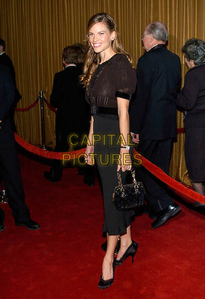 HILARY SWANK.57th Annual DGA Awards held at the Beverly Hilton Hotel, Beverly Hills, California, USA, 29 January 2005..full length black louis vuitton shoes pumps bag.Ref: ADM.www.capitalpictures.com.sales@capitalpictures.com.©Jacqui Wong/AdMedia/Capital Pictures .