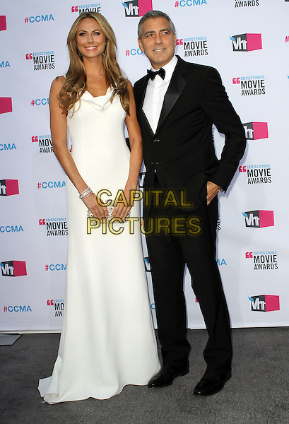 Stacy Keibler and George Clooney.17th Annual Critics Choice Movie Awards held at the Hollywood Palladium, Los Angeles, California, USA..January 12th, 2012.full length white dress maxi black tuxedo bow tie couple hand in pocket tall short.CAP/ADM/KB.©Kevan Brooks/AdMedia/Capital Pictures.