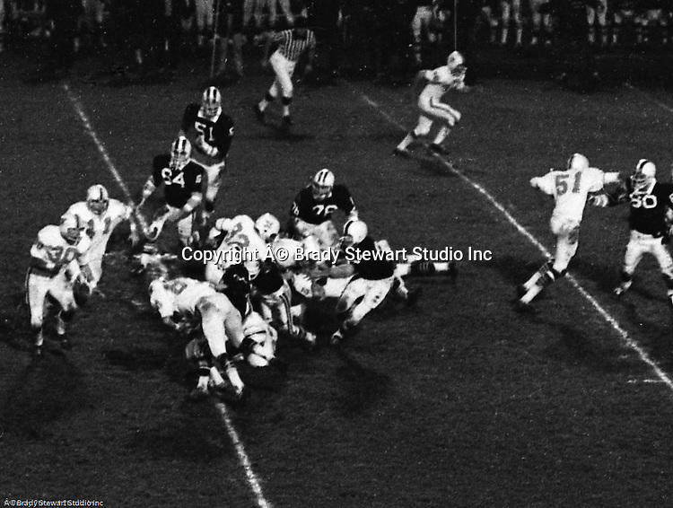 Bethel Park PA:  Offensive play with Mike Stewart getting a first down on an end run after great blocks from Bruce Evanovich 80  and Clark Miller 30.  Others in the photo; Carl Kreisel 40, Don Troup 51, Chip Huggins, Gary Biro 81.  The Bethel Park offense and defense played very well in the 16-0 shut out of the Upper St Clair Panthers. The defensive unit was one of the best in Bethel Park history only allowing a little over 7 points a game.