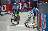 Johan Esteban Chaves (COL/Orica-GreenEDGE) rides alongside/checks teammate Simon Clarke (AUS/Orica-GreenEDGE) after the finish as he needed to get off the bike after going extremely deep in the TTT (which they won)<br /> <br /> 2015 Giro<br /> finish zone of stage 1: San Lorenzo Al Mare - San remo (TTT/17.6km)