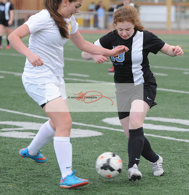 Chugiak's Hannah Fitzgerald works against her Dimond opponent in the second half of their JV soccer contest Tuesday, April 26 at Dimond.  Photo for the Star by Michael Dinneen