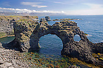 Gatklettur Lava Arch along the Hellnar Coast in Breidavik Bay in West Iceland