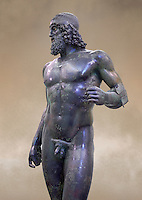 Torso of the Riace bronze Greek statue A cast about 460 BC. statue A was probably sculpted by Myron. The style of the Riace statues straddles the archaic period and heralds the start of the classical period. Both statues depict strong young naked warriors who stand calmly but exuding great power. Museo Nazionale della Magna Grecia,  Reggio Calabria, Italy.