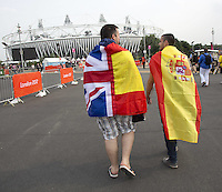 27.07.2012. London England. Spectators in national flags Walk to The Olympic Stadium for The Opening Ceremony of The London 2012 Olympic Games in London