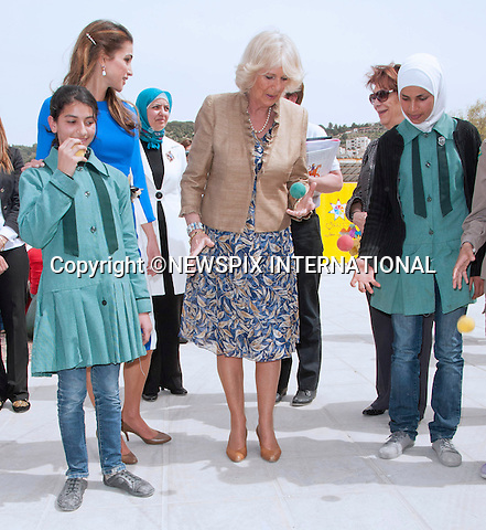 """CAMIILA, DUCHESS OF CORNWALL JUGGLES A BALL WATCHED BY QUEEN RANIA.The Duchess participated in an activity of bouncing a ball and catching it with alternate hands with the school girls from Mahes Secondary School for Girls, Amman_12/03/2013.The Royal couple are on a tour of four Middle Eastern countries..Mandatory credit photo:©DiasImages/NEWSPIX INTERNATIONAL..**ALL FEES PAYABLE TO: """"NEWSPIX INTERNATIONAL""""**..PHOTO CREDIT MANDATORY!!: NEWSPIX INTERNATIONAL(Failure to credit will incur a surcharge of 100% of reproduction fees)..IMMEDIATE CONFIRMATION OF USAGE REQUIRED:.Newspix International, 31 Chinnery Hill, Bishop's Stortford, ENGLAND CM23 3PS.Tel:+441279 324672  ; Fax: +441279656877.Mobile:  0777568 1153.e-mail: info@newspixinternational.co.uk"""