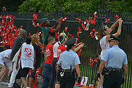 July 24, 2012  (Washington, DC)  13 protesters attach dollar bills and pill bottles to the White House fence. They seek to bring awareness to the HIV/Aids epidemic during the International AIDS Conference in Washington, D.C.    (Photo by Don Baxter/Media Images International)