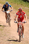June 6, 2009:  Todd Wells (red) and Jeremy Hogan-Kobleski, battle for the lead in the Men's Pro Mountain Bike Race during the Teva Mountain Games, Vail, Colorado.