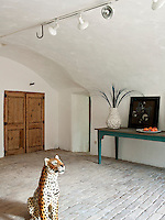 A sculpture of a tiger maintains a watchful eye over the entrance hall
