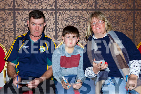 Noel Moloey, Kieran Moloney and Geraldine Moloney at the Gaelscoil Faitleann bingo in the Gleneagle Hotel on Sunday