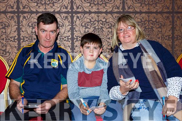 Noel Moloey, Kieran Moloney and Geraldine Moloney at the Gaelscoil Faitleann bingo in the Gleneagle Hotel on Sunday