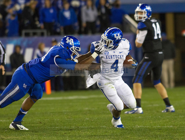 Senior running back Raymond Sanders draws a face mask penalty as he turns the corner. in Lexington, Ky., on Sunday, April, 14, 2013. Photo by James Holt | Staff