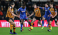 Bolton Wanderers' Sammy Ameobi competing with Hull City's Reece Burke while Bolton Wanderers' Christian Doidge and Hull City's Markus Henriksen look on<br /> <br /> Photographer Andrew Kearns/CameraSport<br /> <br /> The EFL Sky Bet Championship - Hull City v Bolton Wanderers - Tuesday 1st January 2019 - KC Stadium - Hull<br /> <br /> World Copyright © 2019 CameraSport. All rights reserved. 43 Linden Ave. Countesthorpe. Leicester. England. LE8 5PG - Tel: +44 (0) 116 277 4147 - admin@camerasport.com - www.camerasport.com