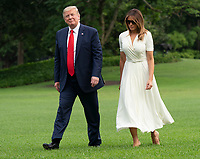 United States President Donald J. Trump and first lady Melania Trump return to the White House in Washington, DC after spending a weekend at their residence in Bedminster, New  Jersey on Sunday, July 7, 2019. Photo Credit: Chris Kleponis/CNP/AdMedia