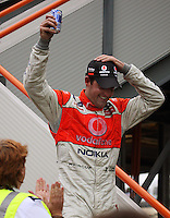Jamie Whincup comes down from the podium after winning Race Two during Day Three of the Hamilton 400 Aussie V8 Supercars Round Two at Frankton, Hamilton, New Zealand on Sunday, 19 April 2009. Photo: Dave Lintott / lintottphoto.co.nz