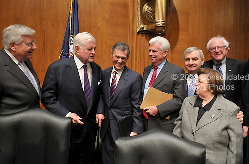 "Washington, D.C. - January 8, 2009 -- Former United States Senator Tom Daschle (Democrat of South Dakota), center, poses for a photo prior to giving testimony before the United States Senate Committee on Health, Labor, Education, and Pensions on his nomination to be Secretary of Health and Human Services in Washington, D.C. on Thursday, January 8, 2009.  From left to right: United States Senator Mike Enzi (Republican of Wyoming), ranking member;  United States Senator Edward M. ""Ted"" Kennedy (Democrat of Massachusetts), Chairman; former Senator Daschle; United States Senator Christopher Dodd (Democrat of Connecticut); United States Senator Jack Reed (Democrat of Rhode Island); United States Senator Barbara Mikulski (Democrat of Maryland); and United States Senator Bernie Sanders (Independent of Vermont)..Credit: Ron Sachs / CNP"