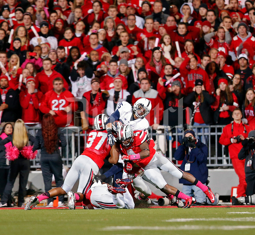 Penn State Nittany Lions wide receiver Brandon Felder (85) scores a touchdown against Ohio State Buckeyes linebacker Joshua Perry (37) and Ohio State Buckeyes safety C.J. Barnett (4) in the 2nd quarter at Ohio Stadium on October 26, 2013.  (Dispatch photo by Kyle Robertson)
