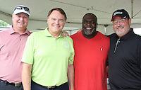 NWA Democrat-Gazette/CARIN SCHOPPMEYER John David Lindsey (from left), Houston Nutt, Marvin Caston and Jerry Jett help support the Broyles Foundation on July 15.