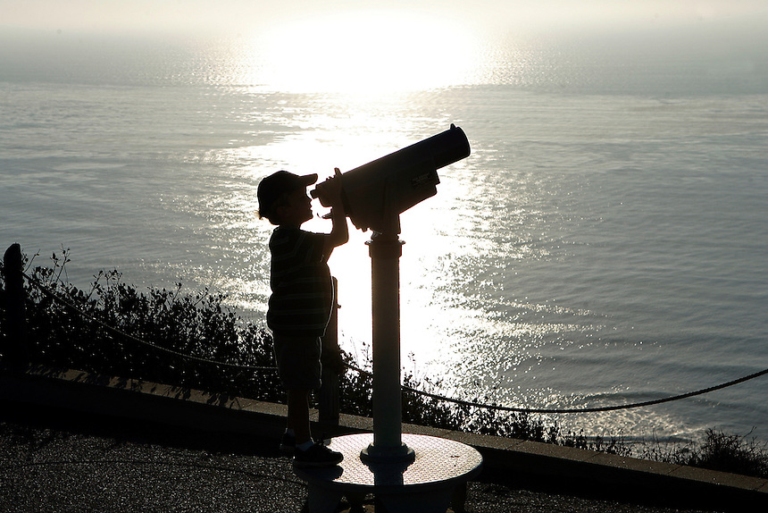 A young boy at the Cabrillo National Monument Lighthouse on Point Loma, San Diego, California.