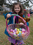 Five year old Zoey, right, shows off her Easter eggs during the Community Easter Egg Dash at Idlewild Park in Reno, Nevada on Saturday, March 31, 2018.