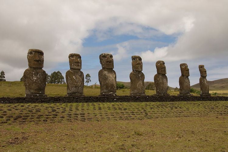Chile, Easter Island: Statues or moai on a platform or ahu at Ahu Akivi, an inland array of moai, unusual because most moai face inland from the edge of the sea..Photo #: ch297-33144.Photo copyright Lee Foster www.fostertravel.com lee@fostertravel.com 510-549-2202
