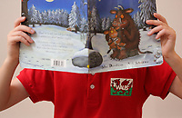 Pictured: One of Alice Morgan's children with a welsh version of Gruffalo. Friday 09 June 2017<br /> Re: Alice Morgan (NOT HER REAL NAME) who has spoken about her experience sending her children to Llangennech Primary School in Carmarthenshire Wales, which will be turned into a Welsh only language medium from a bilingual one.