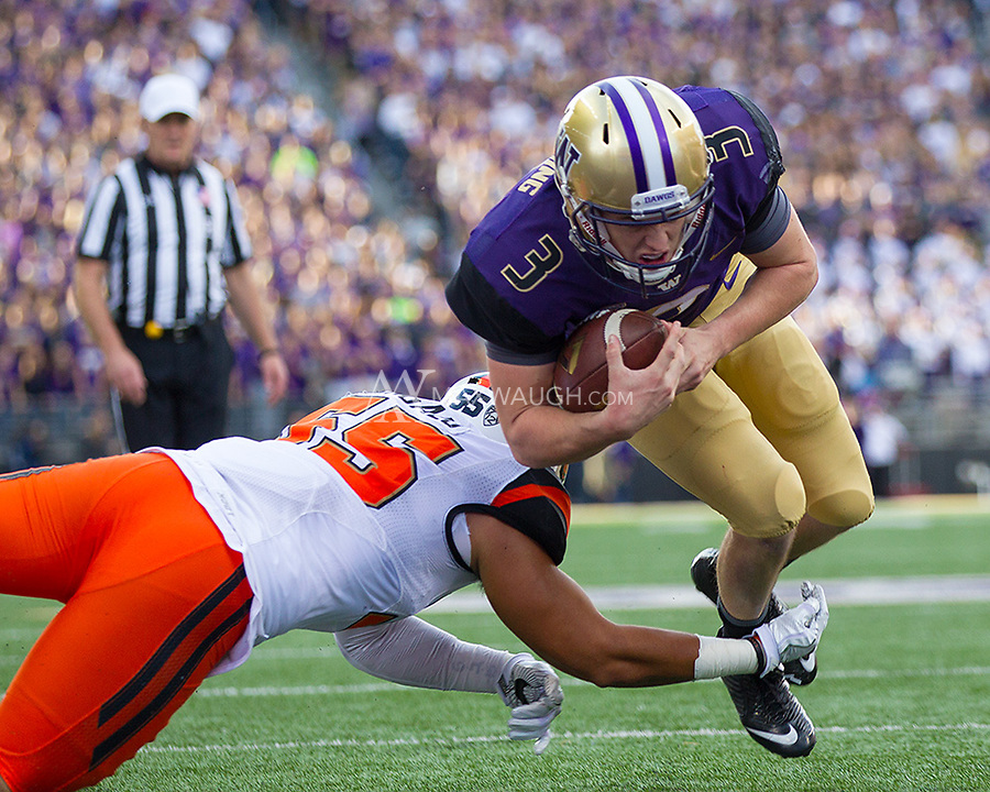 Jake Browning leaps for a touchdown to put the Huskies up by two scores.