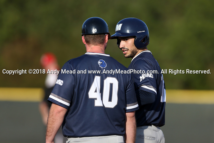 CARY, NC - FEBRUARY 23: Monmouth's Justin Trochiano (16) talks to first base coach Brett Miller (40). The Monmouth University Hawks played the Saint John's University Red Storm on February 23, 2018 on Field 2 at the USA Baseball National Training Complex in Cary, NC in a Division I College Baseball game. St John's won the game 3-0.