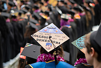 A graduate with a personalized mortarboard, or cap and tassel.<br /> Families, friends, faculty, staff and distinguished guests celebrate the class of 2019 during Occidental College's 137th Commencement ceremony on Sunday, May 19, 2019 in the Remsen Bird Hillside Theater.<br /> <br /> (Photo by Allen Li, Occidental College class of 2020)