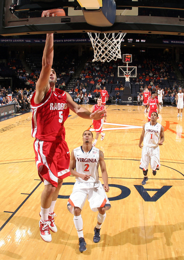 Dec. 07, 2010; Charlottesville, VA, USA; Radford Highlanders guard Gorkem Sonmez (5) shoots the ball in front of Virginia Cavaliers guard Mustapha Farrakhan (2) during the game at the John Paul Jones Arena. Virginia won 54-44. Mandatory Credit: Andrew Shurtleff