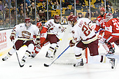 Kevin Hayes (BC - 12), Corey Trivino (BU - 10), Steven Whitney (BC - 21), Paul Carey (BC - 22), Ryan Ruikka (BU - 2), Kieran Millan (BU - 31) - The Boston College Eagles defeated the Boston University Terriers 3-2 (OT) in their Beanpot opener on Monday, February 7, 2011, at TD Garden in Boston, Massachusetts.