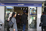 March 18, 2011, Tokyo, Japan - Bank customers are able to use automated telling machines at Mizuho Bank in Tokyo, Japan. ATM service was temporarily suspended in the aftermath of the Tohoku-Kanto Natural Disasters.  (Photo by YUTAKA/AFLO)