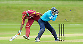 IIC T20 World Cup warm up match - Scotland V West Indies, at the John Paul Getty Oval, in the grounds of Wormsley Estate, Buckinghamshire - keeper Colin Smith, returning after a facial injury which meant he had to wear a helmet for the first time, sweeps through the bailes to run out Windies batsman Keiron Pollard - Picture by Donald MacLeod - 28 May 2009
