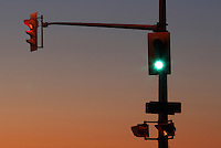 Traffic Signals Against Dusk Sky - One Green, One Red