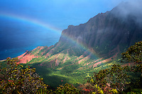 Rainbow as seen from Kalalau Lookout. Waimea Canyon. Kauai, Hawaii