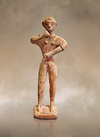 Minoan clay male figurine in the attitude of worship, Chamezi 1900-1700 BC; Heraklion Archaeological  Museum.