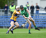 Ross Hayes of Clare in action against Conor Boylan of Limerick during their Munster U-21 hurling quarter final at Cusack park. Photograph by John Kelly.