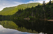 Greeley Ponds Scenic Area - Reflection of mountain range in Upper Greeley Pond in the White Mountains, New Hampshire USA.